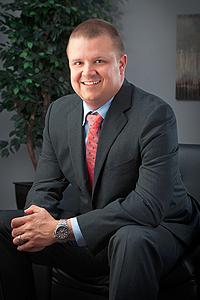 Corey Stenman, Principal